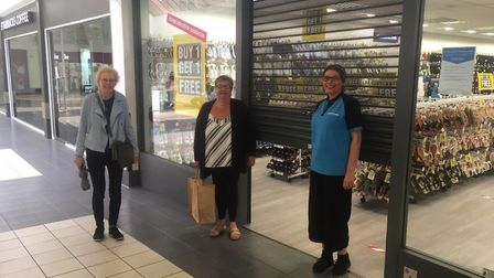 Shoppers Heather Cott and Anna Craze with store manager Karina Jarman outside Shoe Zone which reopen