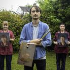 Kyle Ball with Anna Hales, left, and Natalie Weeds, right, after he painted their portraits to honou