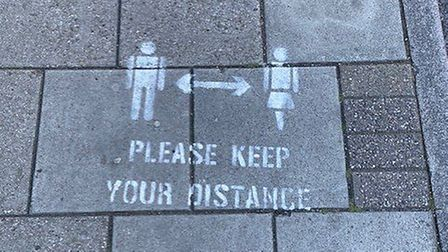 A sign on Gorleston High Street advising people to follow social distancing guidelines. Picture: Gar