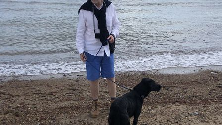Simon Nicholls with Douglas after his swimming ordeal and back on the lead at Winterton. He was resc