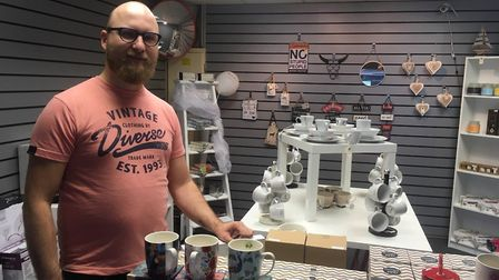 Nowak Pawel inside his shop in Regent Street, Great Yarmouth, called Pretty Things. He is among a nu