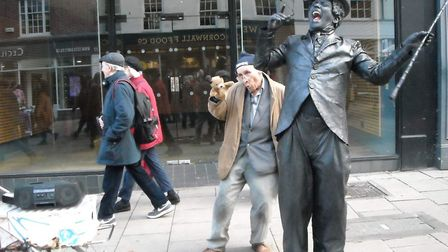 The Puppet Man with Ant Arnold performing as a living Charlie Chaplin statue. The two men are among