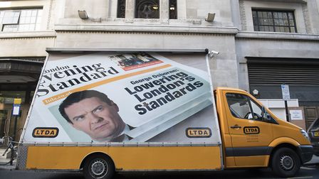 A poster criticising George Osborne's position as the editor of the London Evening Standard outside