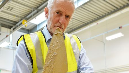 Labour leader Jeremy Corbyn tries his hand at bricklaying during a visit to Barnet and Southgate Col