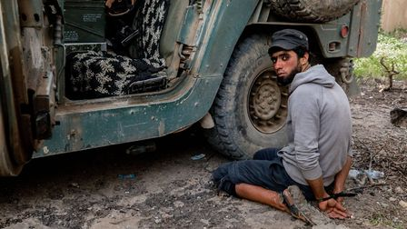 ISIS fighter is captured by Iraqi forces in the Al Thawra neighborhood. (Gabriel Romero)