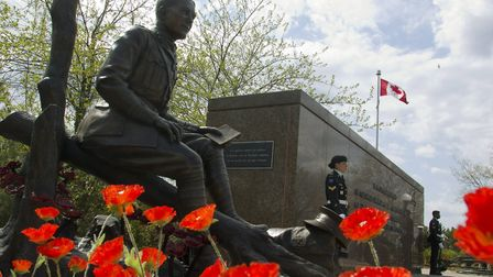Poppies surround the newly unveiled statue of Lt.-Col. John McCrae to commemorate the Second Battle