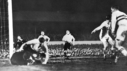 Farago, the Hungarian goalkeeper drops the ball by the post, taking a Wolverhampton Wanderers forwar