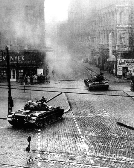 Hungarian Revolution 1956: Russian tanks swinging into the streets of Budapest in the early stages o