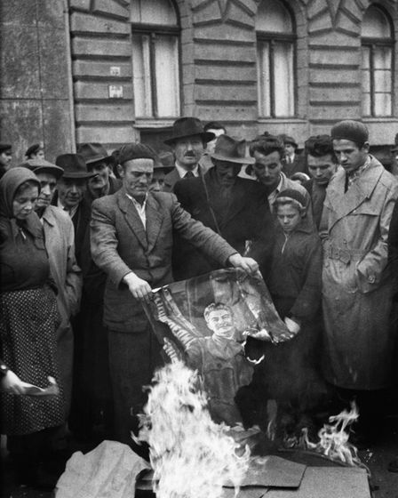 Hungarians burn a picture of the Communist Soviet leader Josef Stalin during the anti-Communist revo