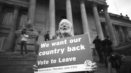 BOLTON, ENGLAND - MAY 25: A Vote to Leave campaigner holds a placard as Leader of the United Kingdo