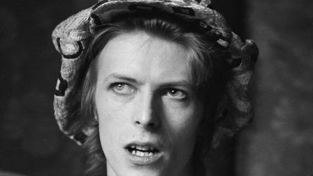 Singer David Bowie (1947 - 2016) being interviewed at his ground floor flat at Haddon Hall, where he
