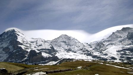 The picture shows the eastern walls of the mountains, from left, Eiger (3,970m), Moench (4,107m) and