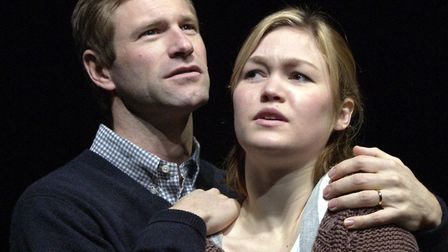 Actors Julia Stiles and Aaron Eckhart perform on stage during a rehearsal of Oleanna at the Garrick