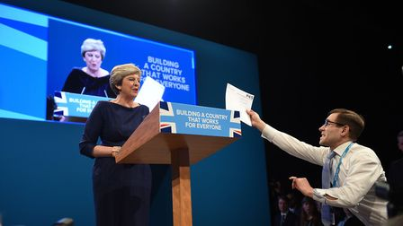 Comedian Simon Brodkin, also known as Lee Nelson confronts Prime Minister Theresa May during her key