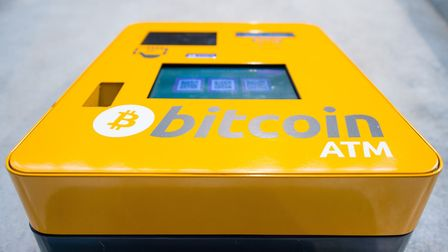 A bitcoin ATM. Each bitcoin is now worth nearly $12,000. Picture: Dominic Lipinski/PA Wire