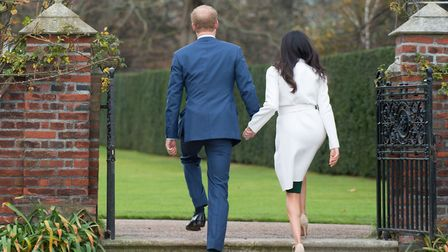 Prince Harry and Meghan Markle in the Sunken Garden at Kensington Palace. Picture: PA
