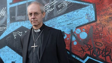 The Archbishop of Canterbury, Justin Welby during his visit to Belfast, stops at the Peace Wall. Pic
