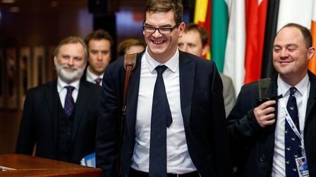 Oliver Robbins, permanent secretary for the Department for Exiting the European Union (EU), center,