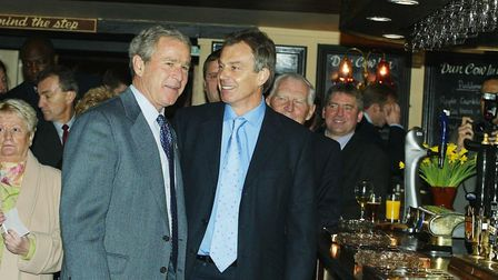 US President George Bush alongside Prime Minister Tony Blair at the Dun Cow pub, during a visit to M