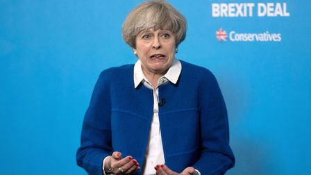 Theresa May speaks during a General Election campaign visit to Grand Station in Wolverhampton in the