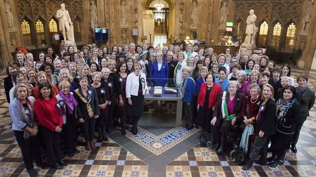 UK Parliament undated handout photo of Prime Minister Theresa May joins female Members of both Hous