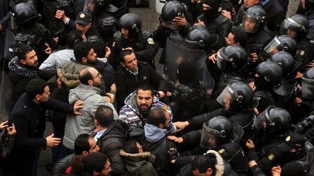 Tunisian protesters confront security forces blocking access to the governorate's offices in Tunis d