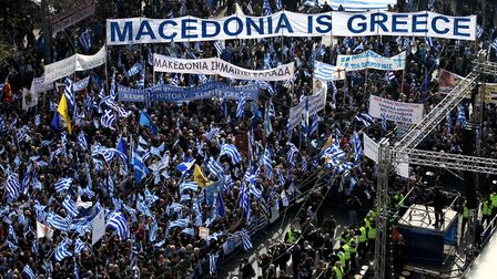 Demonstrators wave Greek national flags during a demonstration February 4, 2018 in Athens, Greece. P