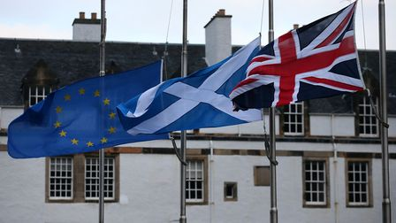 An European Union, a Saltire and an Union flag fly outside the Scottish Parliament in Edinburgh