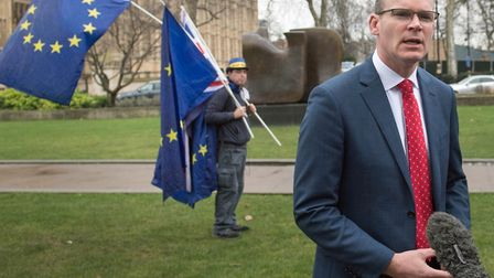 Irish Foreign Affairs Minister Simon Coveney speaks to the media on College Green in Westminster, Lo