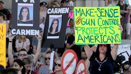 Protesters attend a rally at the Federal Courthouse in Fort Lauderdale to demand government action o
