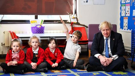 Boris Johnson sits with Year 1 pupils during a visit to St Leonard's Church of England Primary Acade
