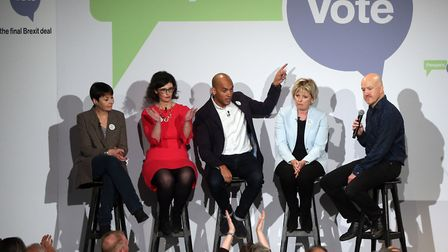 Politicians Caroline Lucas, left, Layla Moran, Chuka Umunna, and Anna Soubry are joined onstage by c