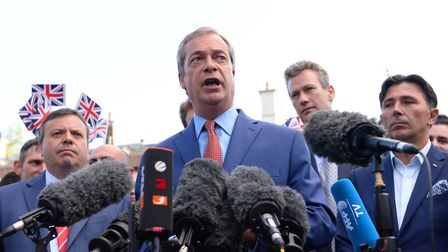 Nigel Farage flanked by Arron Banks (left) and Andy Wigmore (ahem ... far right)