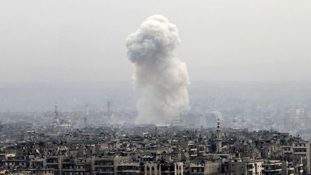 Smoke rises following a Syrian government air strike on rebel positions, in eastern Aleppo, Syria on