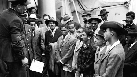 Jamaican immigrants welcomed by RAF officials from the Colonial Office after the ex-troopship HMT 'E