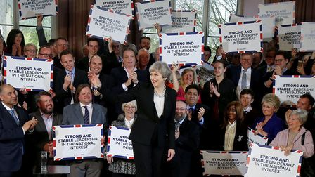 Britain's Prime Minister Theresa May (C) delivers a speech to Conservative Party members as they lau