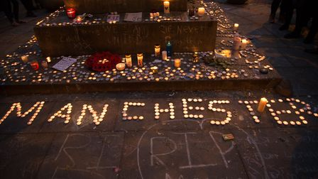 Candles, as a tribute for the victims of the Manchester Arena attack, in Manchester, United Kingdom,