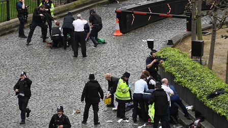 Review of the Year 2017: March: A policeman points a gun at Khalid Masood, (on the floor at the top