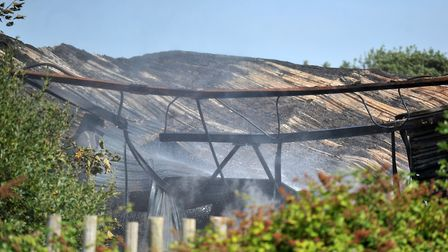 Steam rising from the site of a large fire at the former Pontins holiday park in Hemsby. Picture: Ja
