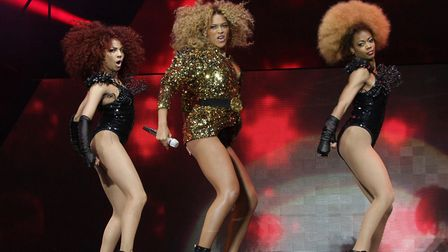 Beyonce (centre), with backing dancers, performing on the Pyramid Stage at the Glastonbury Music Fes