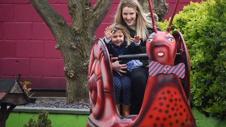 Kirsty Friday and her daughter Darcie, two, ride the ever popular Joyland Snails at Great Yarmouth.