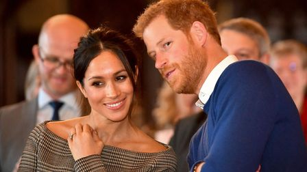 Prince Harry whispers to Meghan Markle as they watch a dance performance by Jukebox Collective in th