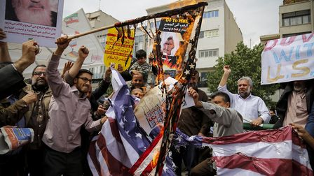 Iranian demonstrators burn American flags during a protest in Tehran, Iran on May 11, 2018, followin