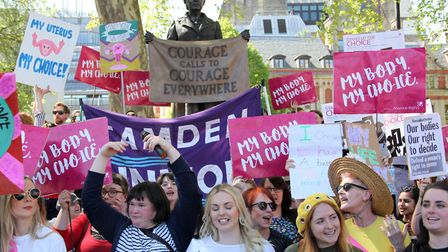 Pro-choice demonstrators pose next to statue of Suffragist Millicent Fawcett in London, UK on May 5,