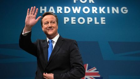 Prime Minister David Cameron waves after making his keynote speech on the final day of the Conservat
