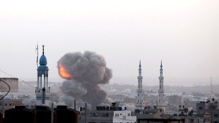 A fire ball rises as the Israeli air force carries out a raid over Gaza City on November 17, 2012, f