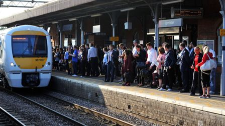 Commuters waiting for a train on the c2c line. PA WIRE/Nick Ansell