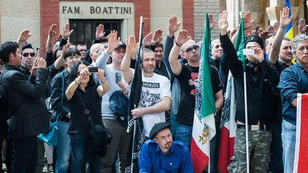 Members of the Italian far-right are seen giving the Roman salute during the celebration of the life