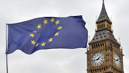 Photo of an EU flag flying in front of the Houses of Parliament in London. Photo: Victoria Jones/PA