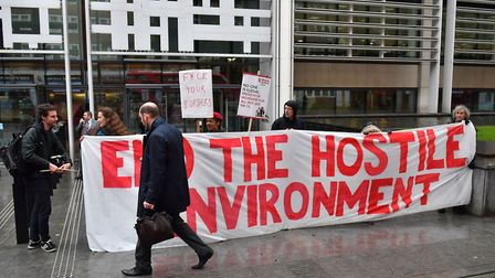 Demonstrators protest against the hostile environment immigration policy outside the Home Office in